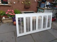 Wooden window shutters with moveable louvre slats
