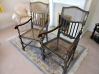 A pair of antique wicker chairs, one in need of repair.