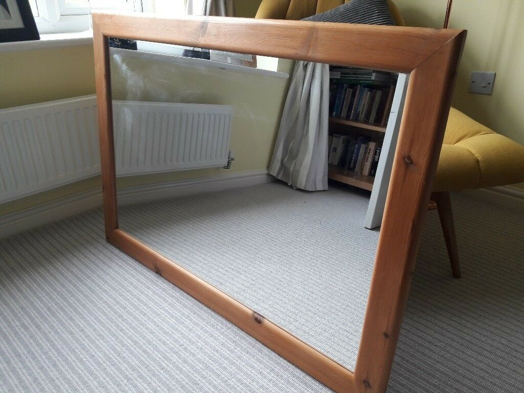 Large wooden framed mirrorin Darlington, County Durham - Large pine/wood framed mirror. Simple design. A few marks from moving house but nothing that spoils its appearance when hung. 1040mm x 735mm Please let me know if you have any questions. Thanks for looking