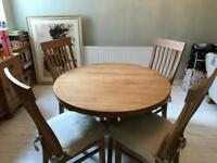 Solid oak extendable dining table and four chairs