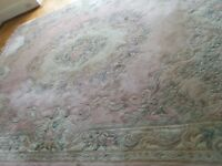 Large wool rug, pink with centre flower, antique style