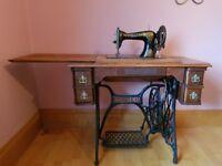 Vintage singer sewing machine and integral desk.