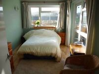 Bright sunny double room with ensuite bathroom, private entrance and parking
