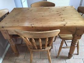 Solid Farmhouse Pine Table And Four fiddle back chairs.