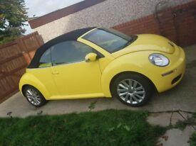 Volkswagen Beetle convertible. Low mileage. Good condition.