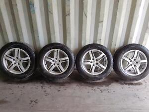 215 60 16 Pontiac G6 All Weather Tires with ALLOY WHEELS