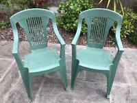 2 x green high back plastic chairs