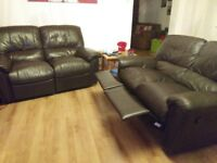 2 x Two-seater faux leather recliner sofas