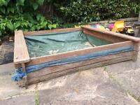 Wooden Plum sandpit
