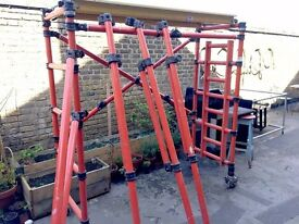 Electrician's scaffolding, fibreglass. One man folding operation. with all castor wheels and legs.