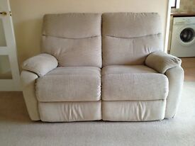 Sofa. Two seat cream fabric recliner.
