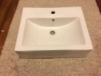 Porcelain basin plus tap and waste, all brand new.