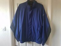 For sale Footjoy Dryjoy windproof jacket in blue. Very Good condition. Size XL