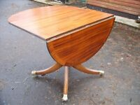 single pedestal drop leaf side table, solid mahogany, brass castors, brilliant conditions, 4 seater