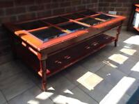 Solid flame mahogany coffee table with glass panels excellent very good condition