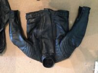 Rhino leather motorbike , included back and arm protectors. No size on it but fits male medium