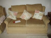 Two seater cream sofa good condition
