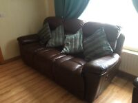 Stunning leather reclining sofa and arm chair