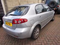 DAEWOO/CHEVROLET LACETTI 2005 WITH PRIVATE REG BARGAIN STARTS DRIVES NEEDS RADIATOR LONG MOT