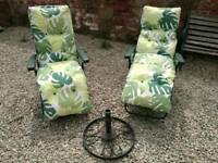 2x garden recliners with parasol base