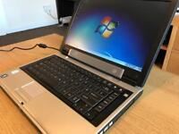 "GREAT LITTLE WINDOWS 7 TOSHIBA LAPTOP 14.1"" INTEL CORE LAPTOP 60GB HDD 1.5GB RAM AND OFFICE 2007 PRO"