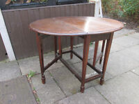 hard wood round table can be tucked away as it folds