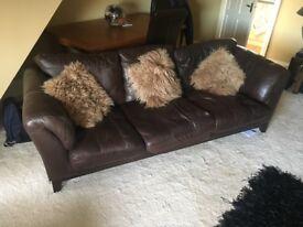 Chocolate brown 3 seat sofa and swivel chair