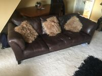Chocolate brown 3 seat sofa and swivel chair