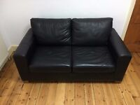 Black leather sofa bed - 2 seater