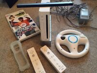 Nintendo Wii console, two controllers, wheel and nunchuk plus 3 games included