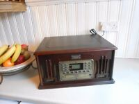 classic collectors record player cd and cassett and radio in a dark oak case