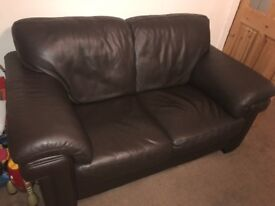 Two seat leather sofa and leg rest. MUST COLLECT.