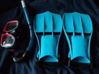 A pair of flippers with mask & snorkel. The flippers have 5,6,7 on the base.