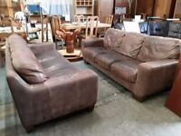 Pair of brown leather 3 seater sofas