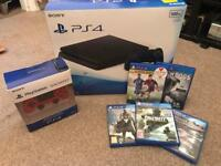 PlayStation 4 (PS4) with controllers and games