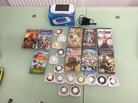 PSP White with charger, manual, 20 games and 3 movies