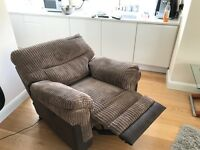 DFS Brown fabric electric reclining armchair