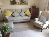 Large cream sofa and footstool