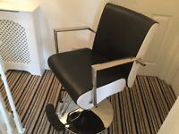 3 beautiful black and white hairdressing chairs and a black barber chair