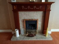 Gas fire unused with marble and wood surround