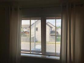 Cream full length curtains