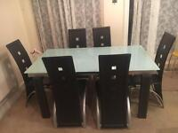 Extendable glass dinning table and 6 chairs
