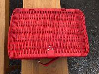 Red wicker picnic hamper