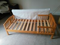 Child's bed suitable for toddler with safety side rails