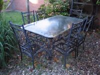 Ornate metal table and six chairs