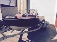 1996 16.5' Lund Tyree boat with 115 Evinrude engine
