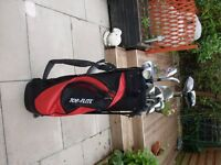 for sale folding golf trolly with various golf clubs and a topflight carry bag