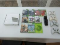 XBox 360 in white + 4 wireless controls + charging station