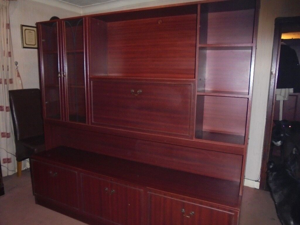 Wall unit with three cupboards, glass door storage plus pull down drinks unit