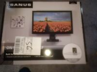 Brand new unopened Sanus VMA401-B1 on wall av glass shelf